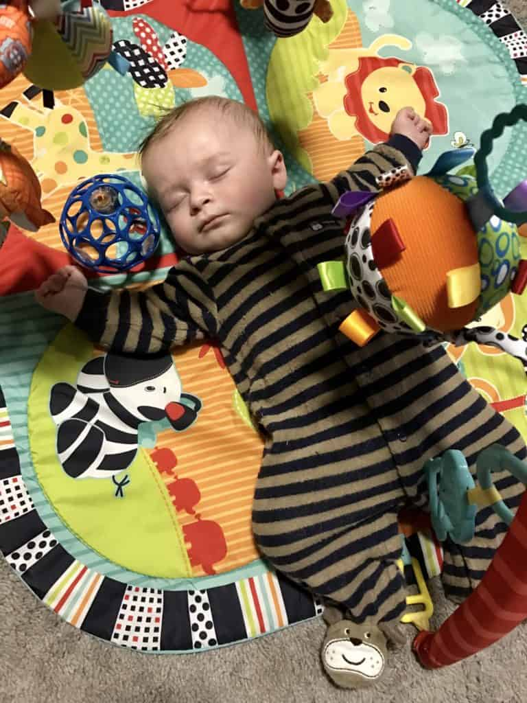 Sleeping Baby with Toys