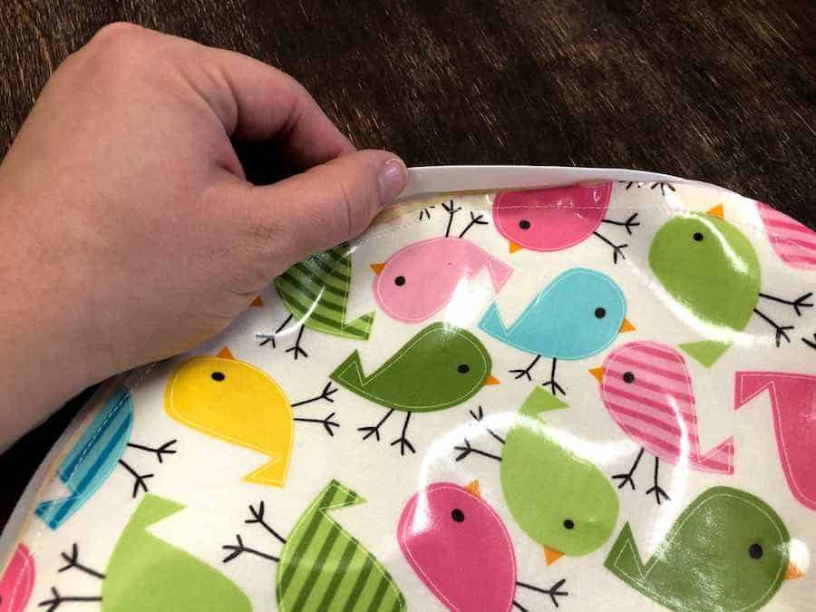 tucking in edges of fabric and bias tape