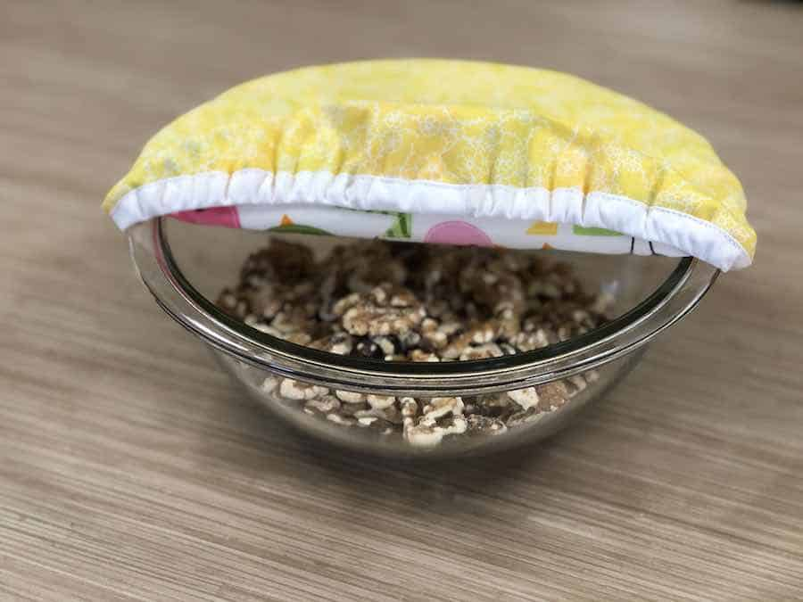 Finished Reusable Bowl cover over bowl of Walnuts