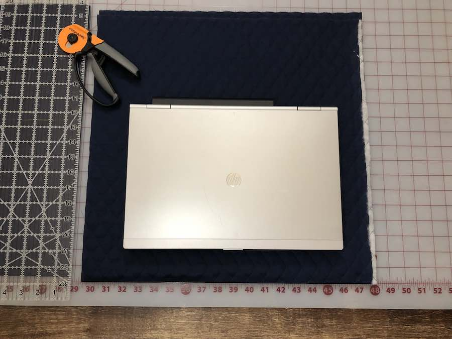 Lay your laptop on your fabric