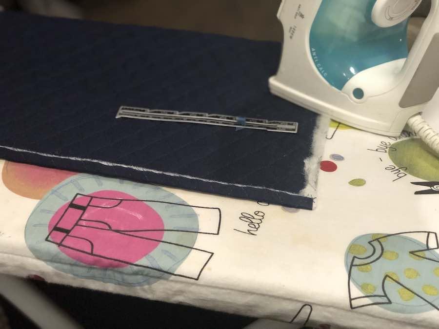 Press bottom edge of fabric