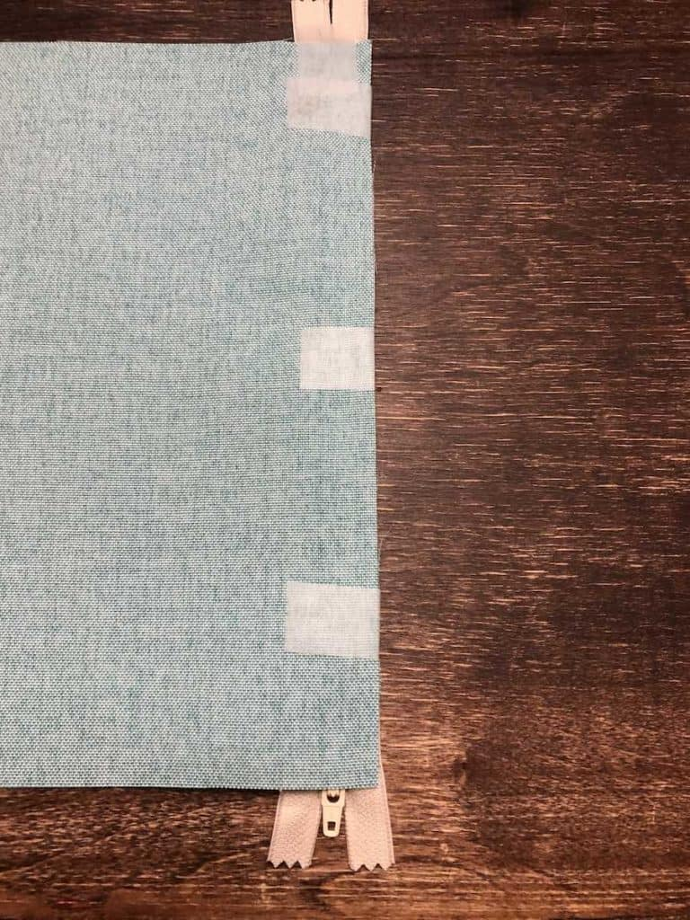 Tape fabric into place