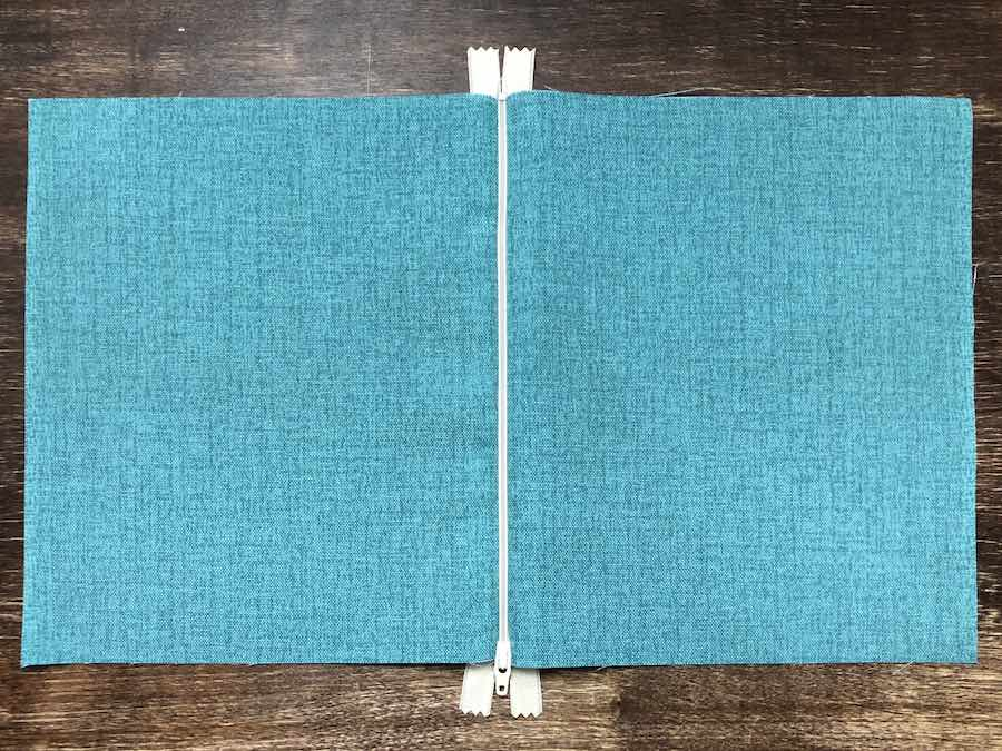 8 Lay fabric out flat with zipper in the middle