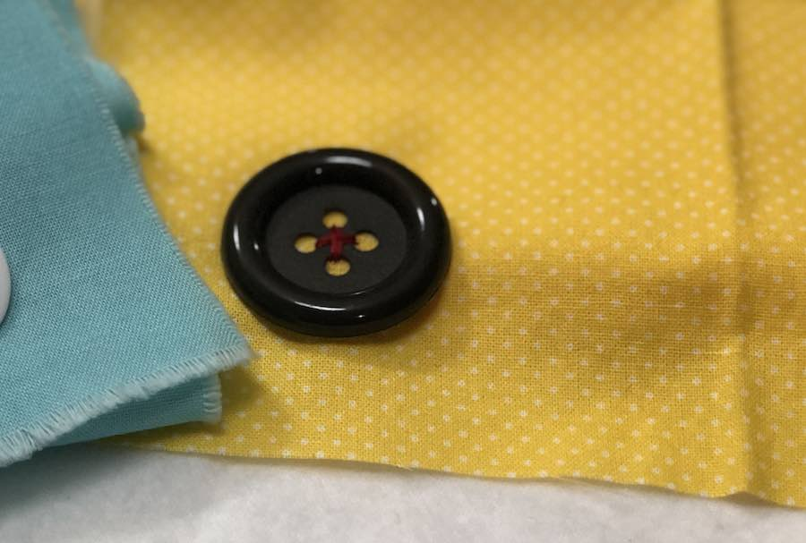 Sew a 4 hole button by hand completed
