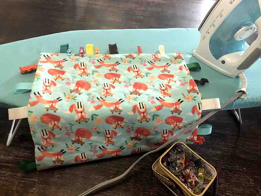 pressing edges of baby tag blanket