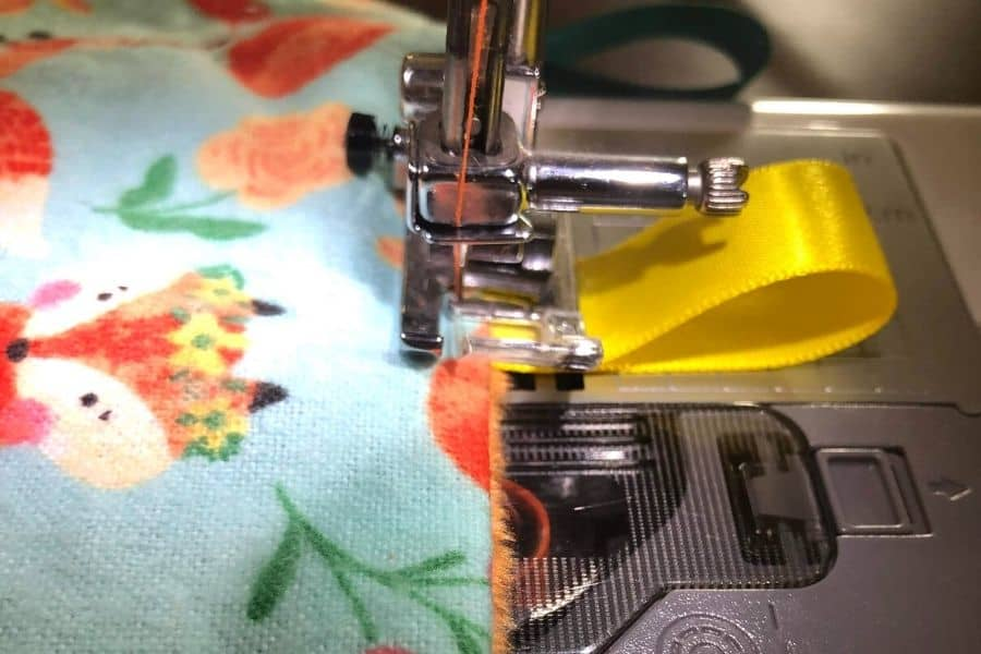 sewing on final ribbons