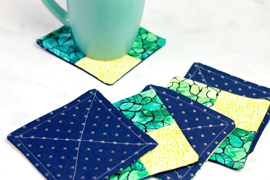 sewing an x on the back of the coaster