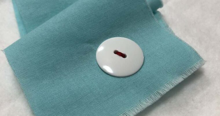 How to Sew a Two-hole Button By Hand