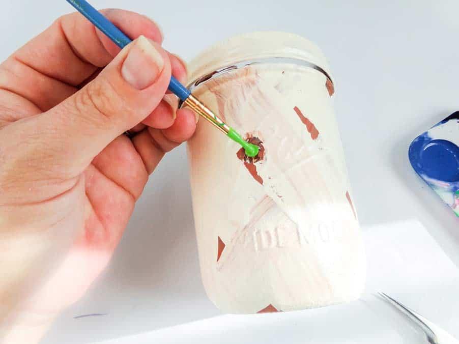 painting eye on mummy jar