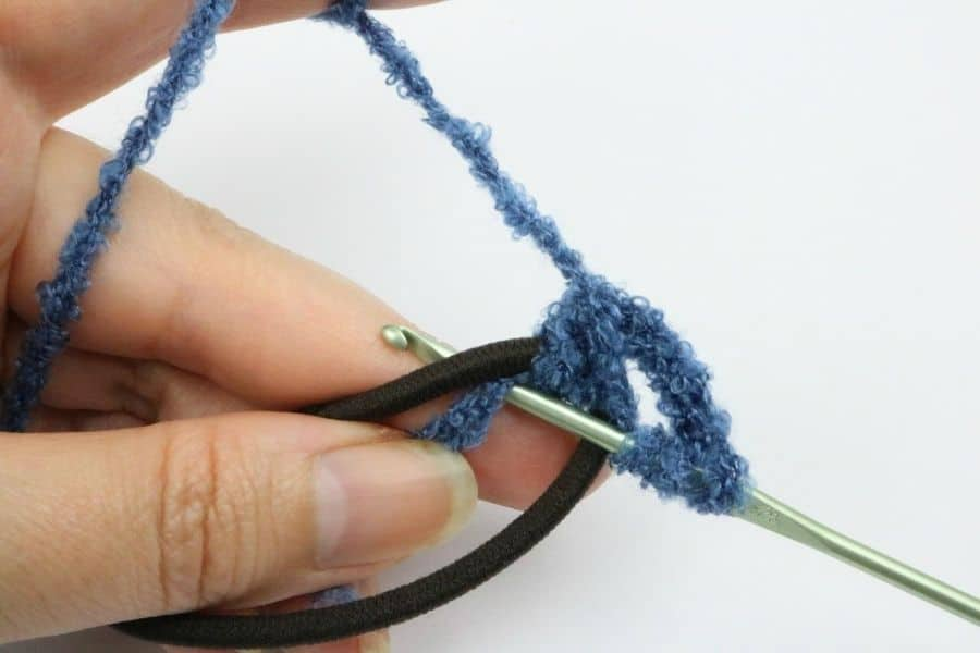 putting needle through