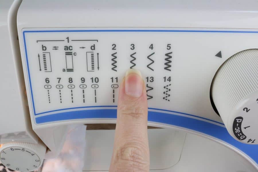 Change the stitch to a zigzag stitch