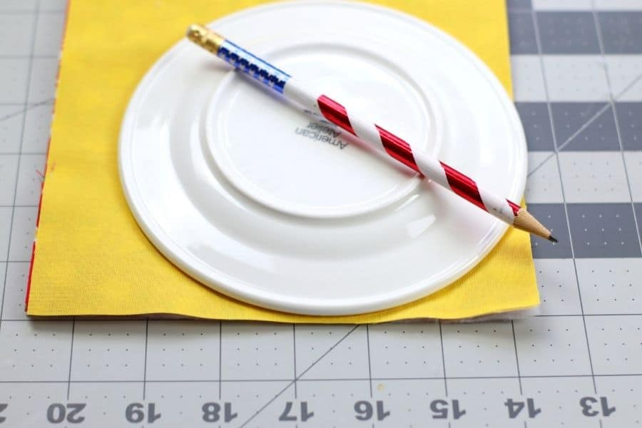 cutting out a circle with the fabric