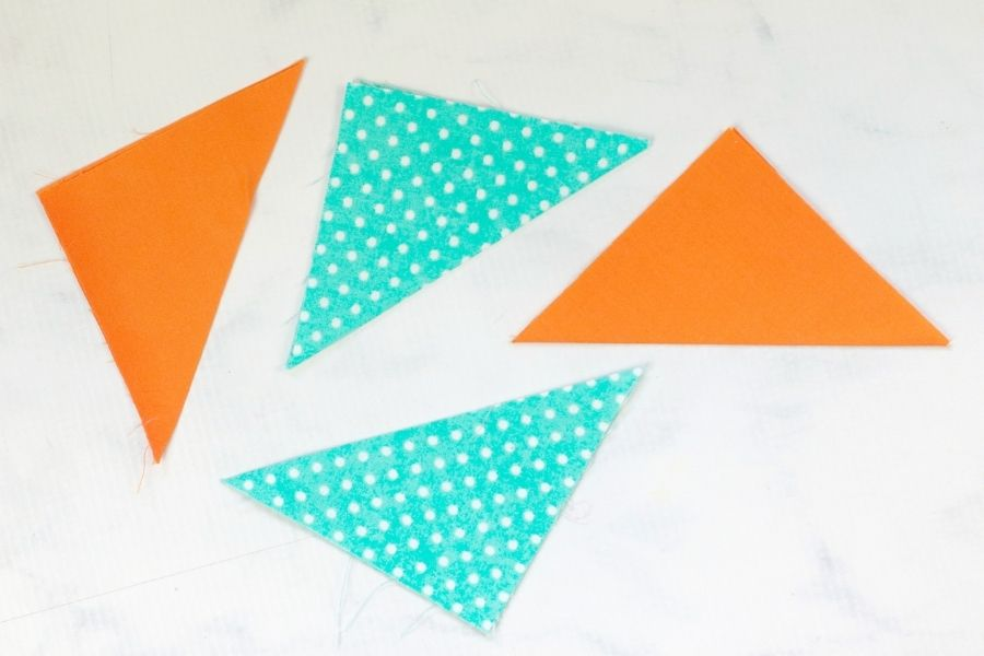 cutting the triangles out of the fabric