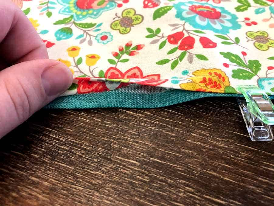 fold in fabric hole of DIY Reversible Placemats