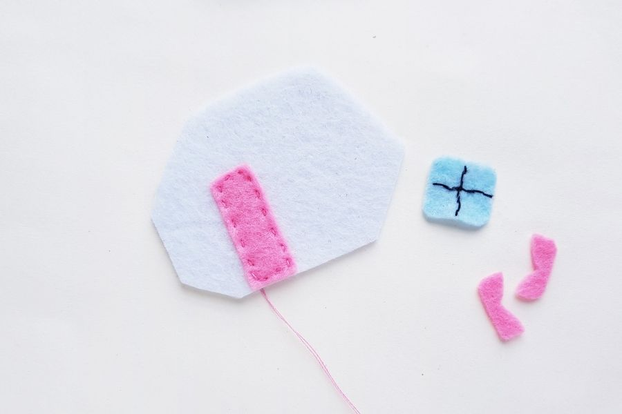 sewing on the door to easy sew felt camper