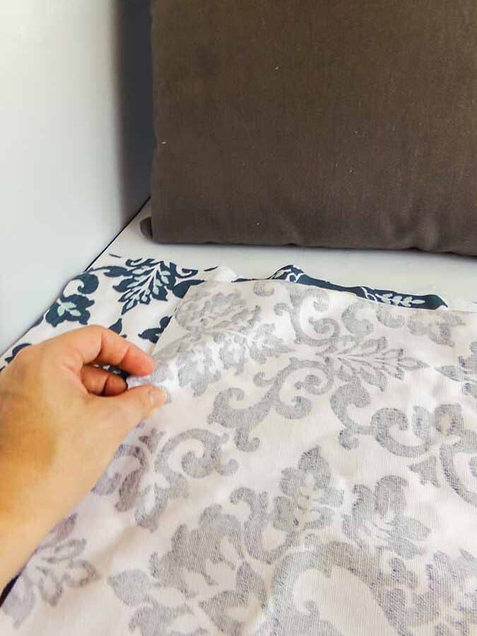 gluing sides of no sew pillow cover together