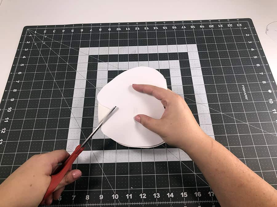 finishing cutting out tooth fairy pattern with scissors