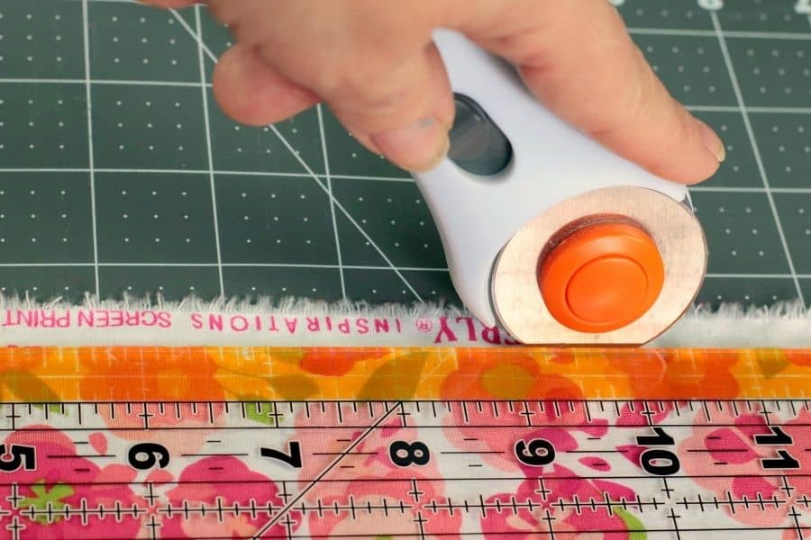 cutting the fabric into square