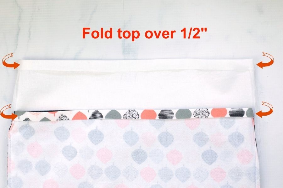 ironing and folding the top edge