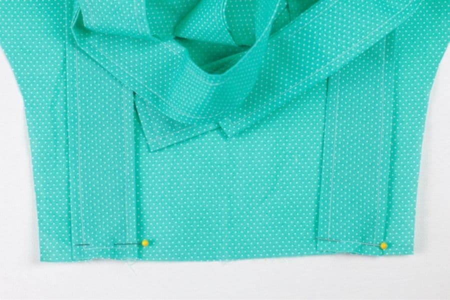 pinning the ties for the apron with free printable pattern