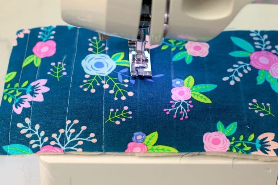 sewing the stitches on the purse