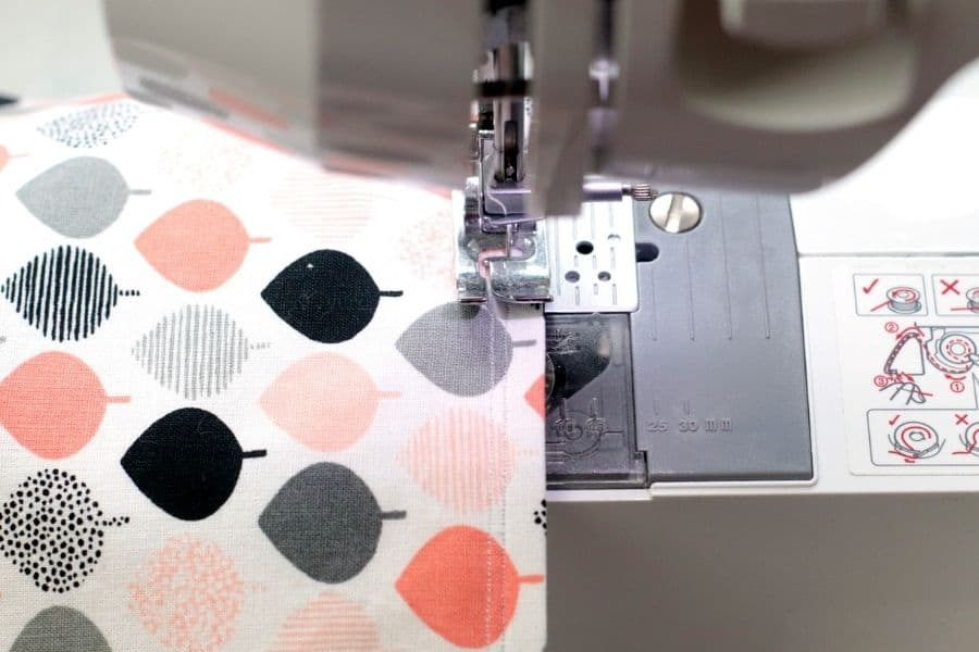 using sewing machine to sew edge of the Envelope Clutch Purse