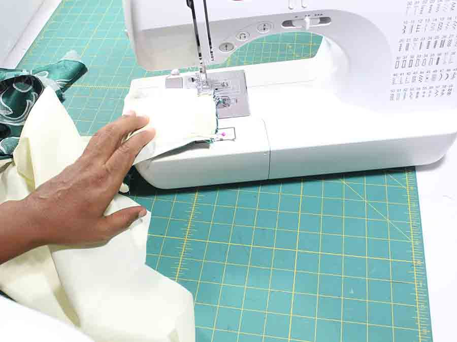 Pin the raw edges of both handles together and sew across the top