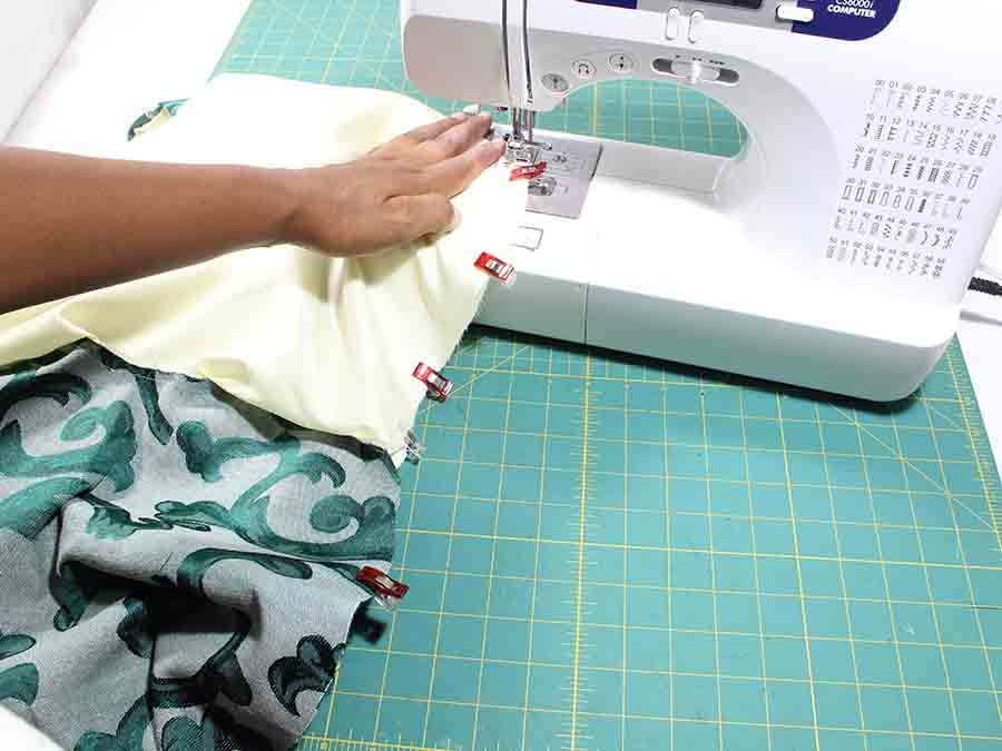 Sew the side seam from the main fabric continuing to the end of the lining