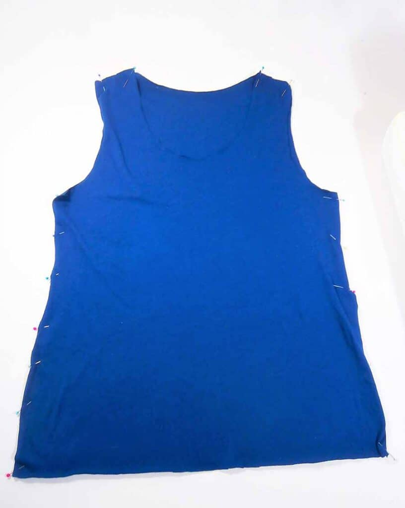 pin front and back of classic tank top together along shoulder and side seams.