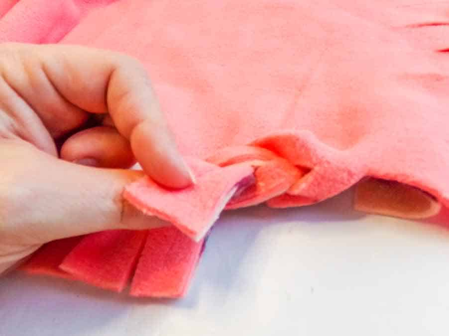 braid together the edges of the no-sew baby blanket
