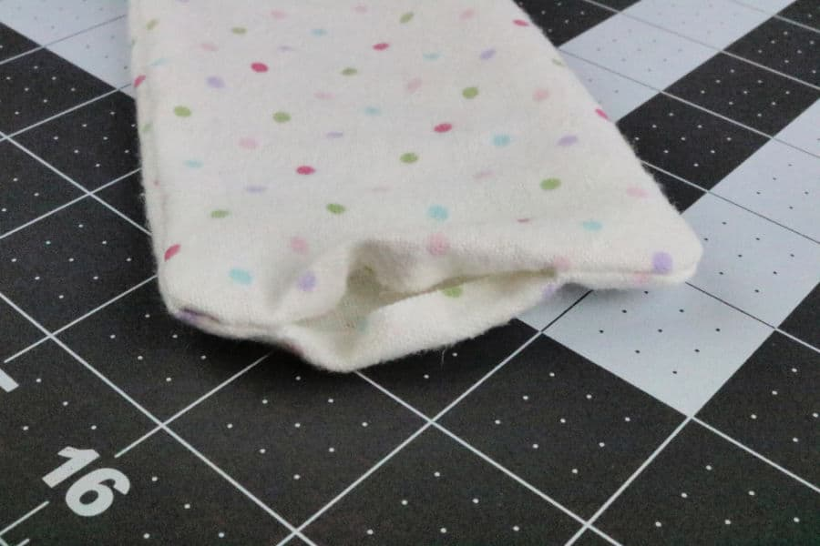 Fold the raw edges in and sew shut