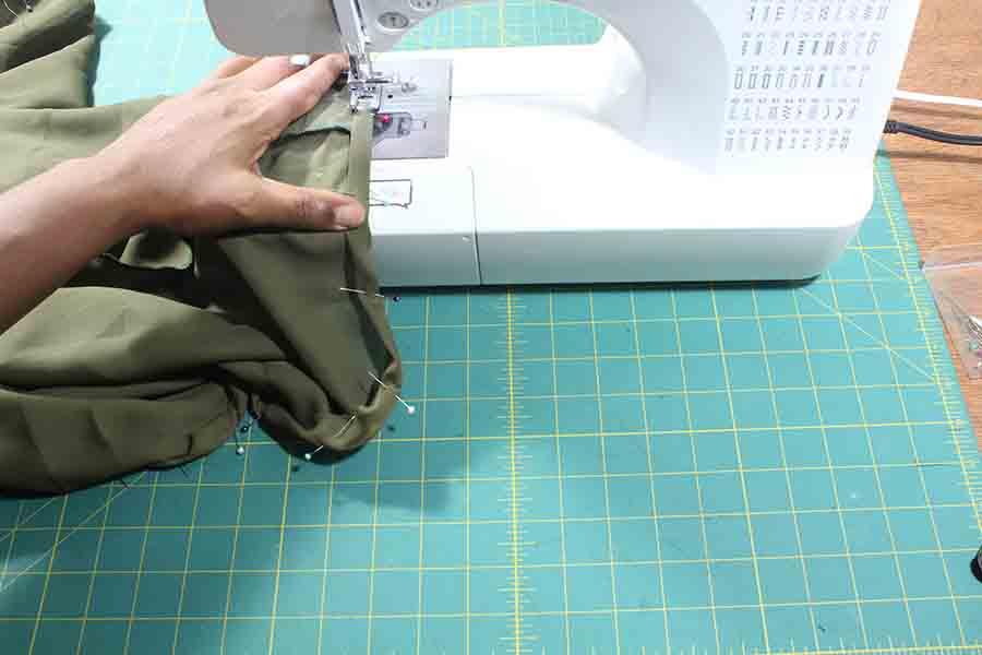 sewing hem of peasant blouse