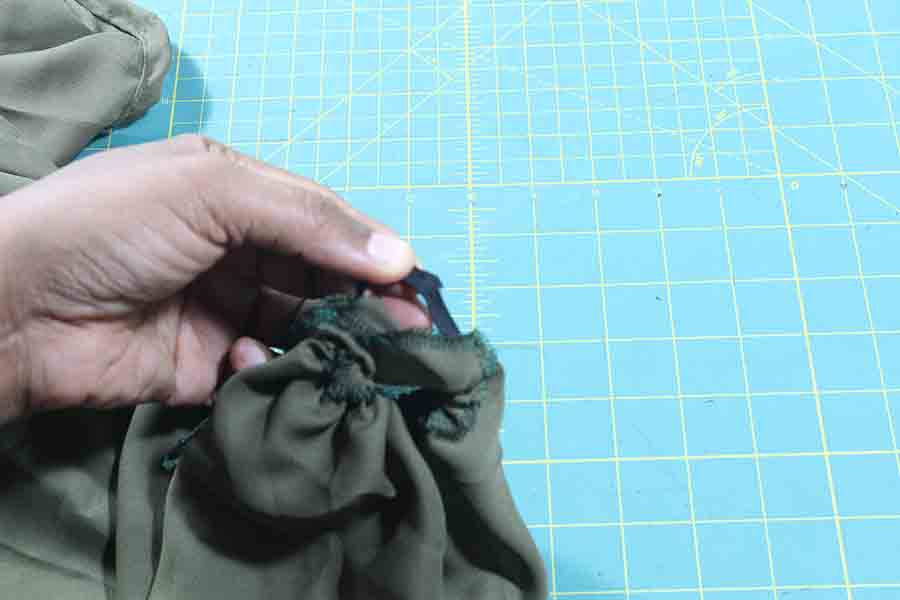 overlap ends and sew elastic for peasant blouse sleeves