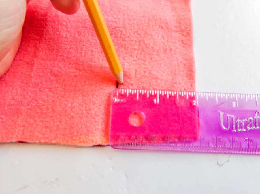 measure corners on no-sew baby blanket
