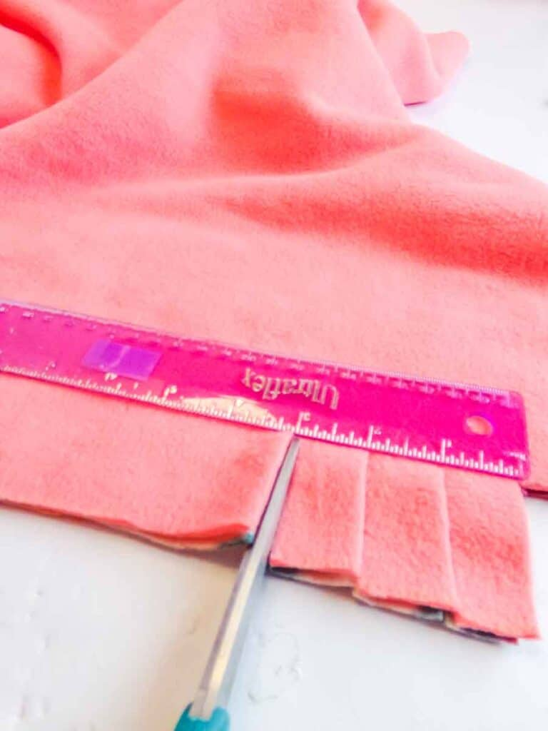 cut strips to braid no-sew baby blanket