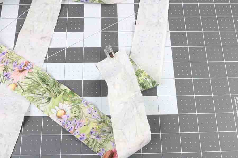 clip fabric strips together at end
