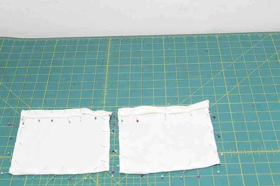fold over and pin top of robe pocket