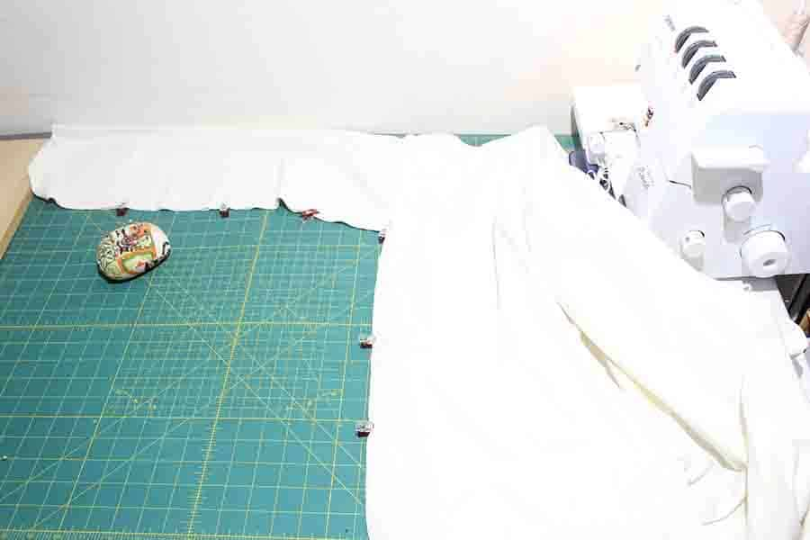 pinning sleeves and side seams of robe