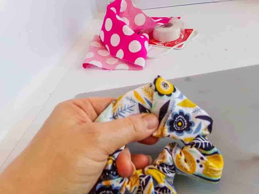 tuck one end of your no-sew scrunchie inside the other