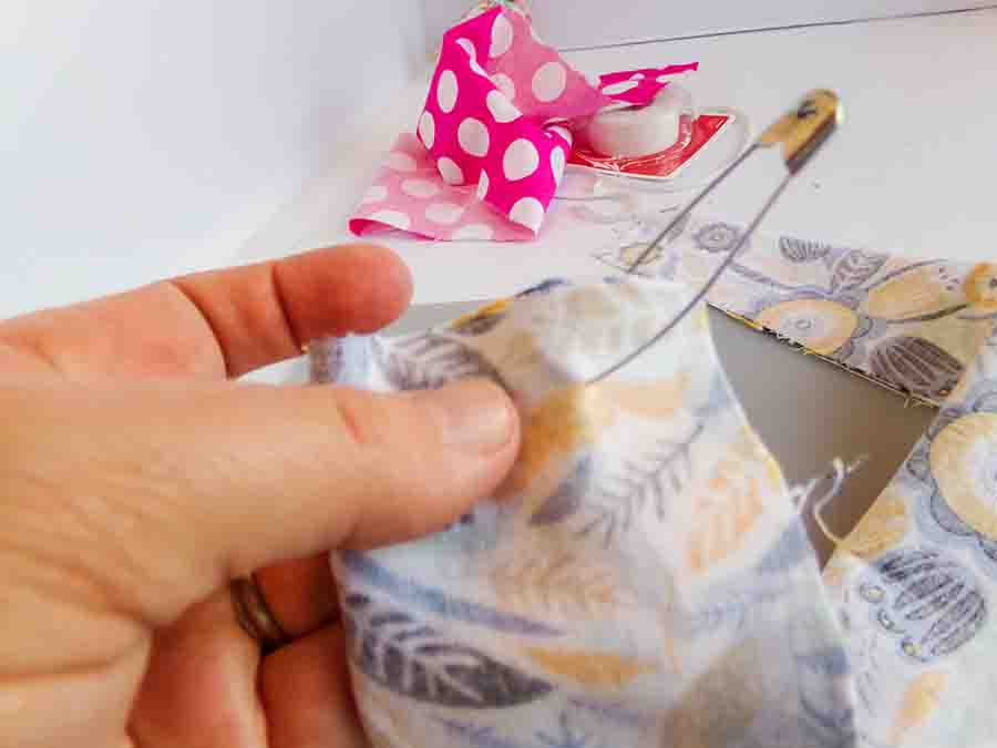attach safety pin to hemmed fabric