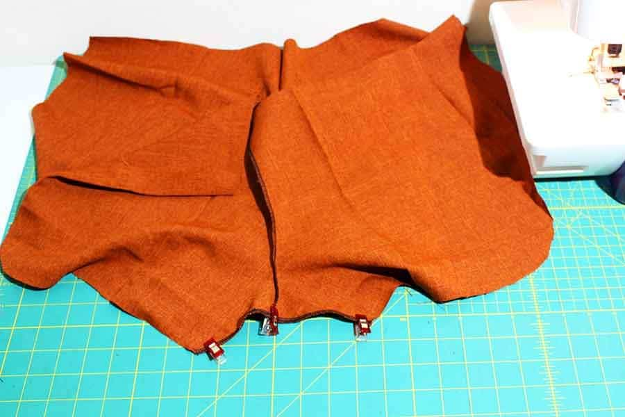 pin front and back gym shorts pieces together at crotch & sew