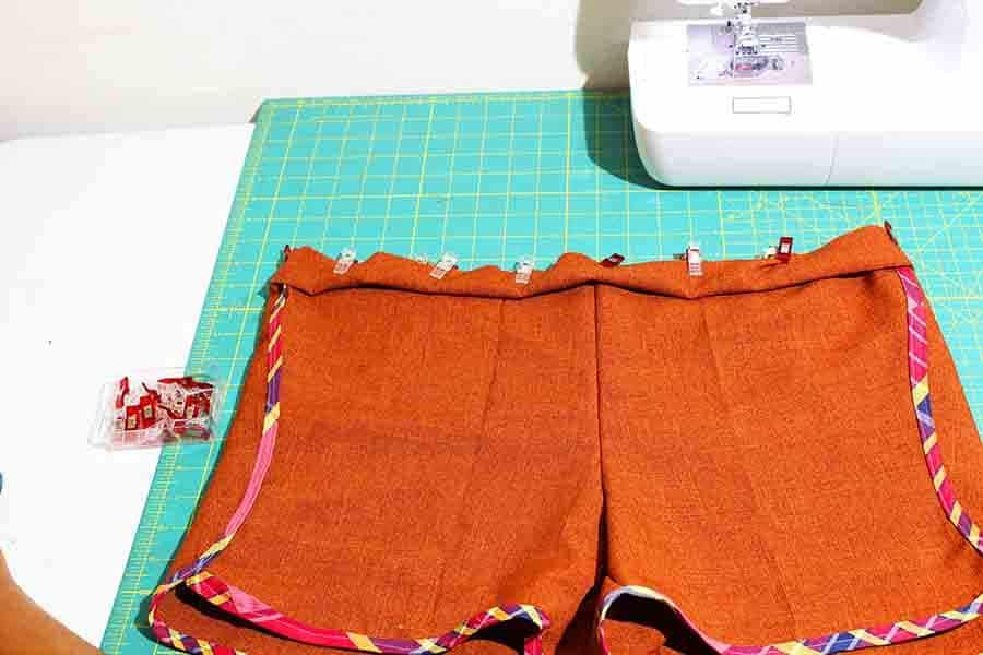 Fold the waistband wrong sides together. Pin the waistband to the shorts aligning raw edges.
