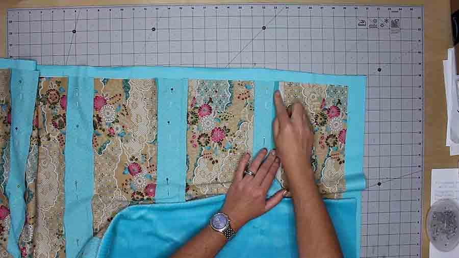 finger press open seams of baby rag quilt