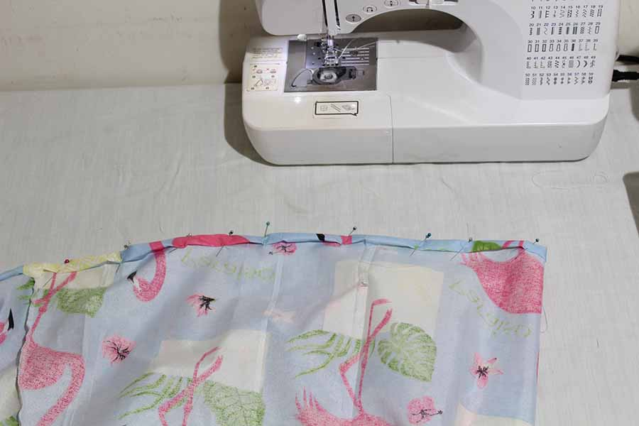 """Fold the skirt hem by 1/2"""" then by another 1/2""""."""