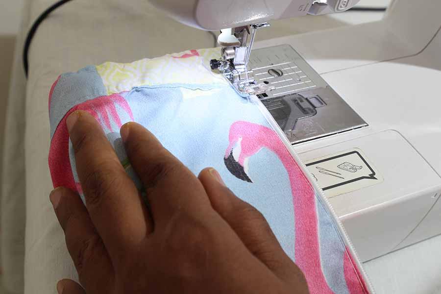 sew folded left hand edge of a-line skirt over zipper