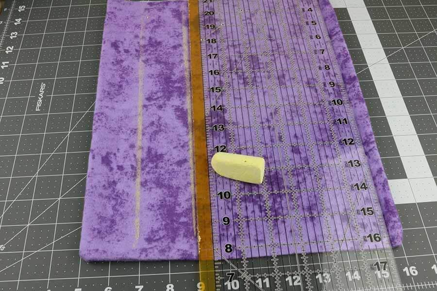 mark lines down heating pad to create baffles